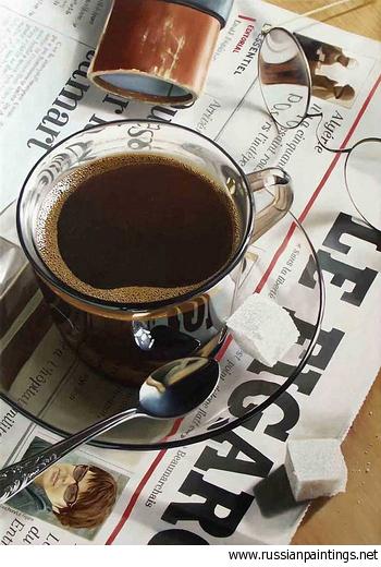 прозрачная чашка с кофе на газете