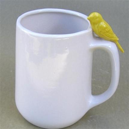 Кофейная чашка с канарейкой